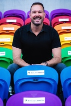 Pride Leadership author Dr. Steve Yacovelli. Photo by Photo by J.D. Casto. Taken in the Orlando City Soccer Stadium at the 49 seats dedicated to the victims of the Pulse shooting. This photo was selected to celebrate and remember their lives.